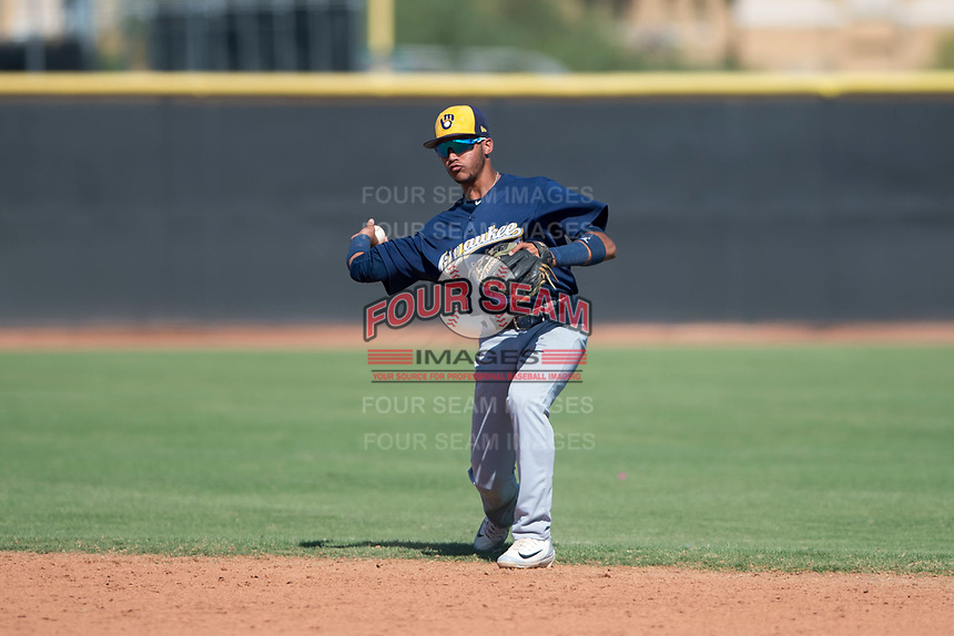 Milwaukee Brewers second baseman Daniel Castillo (65) throws to first base during an Instructional League game against the San Diego Padres at Peoria Sports Complex on September 21, 2018 in Peoria, Arizona. (Zachary Lucy/Four Seam Images)