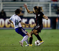 Tobin Heath (17) of the USWNT fights for the ball with .Emi Nakajima (17) of Japan during the game at WakeMed Soccer Park in Cary, NC.   The USWNT defeated Japan, 2-0.