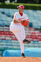 Pitcher Wang Pie (18) of the China National Team during a game vs. the Washington Nationals Instructional League team at Holman Stadium in Vero Beach, Florida September 28, 2010.   China is in Florida training for the Asia games which will be played in Guangzhou, China in November.  Photo By Mike Janes/Four Seam Images