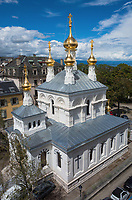 """Switzerland. Geneva.The Russian Church (full name: Cathédrale de l'Exaltation de la Sainte Croix) is designed in a Byzantine Moscovite style. The church is a lovely 19th-century Russian Orthodox church topped with golden onion domes. The church, facade. roof and all onion domes underwent a complete revival restoration. The newly restored bulbs are gilded with golden leaves. The term gilding covers a number of decorative techniques for applying fine gold leaf to solid surfaces such as onion domes and crosses. A gilded object is also described as """"gilt"""". The Russian church serves today not only the Russian community but also Bulgarians, Serbs, Coptic Christians and other Orthodox worshippers who do not have their own church in Geneva. An onion dome is a dome whose shape resembles an onion. Such domes are often larger in diameter than the drum upon which they sit, and their height usually exceeds their width. These bulbous structures taper smoothly to a point. 10.08.2017 © 2017 Didier Ruef"""
