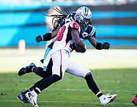 CHARLOTTE, NC - NOVEMBER 17: Javien Elliott #23 of the Carolina Panthers tackles Kenjon Barner #38 of the Atlanta Falcons during a game between Atlanta Falcons and Carolina Panthers at Bank of America Stadium on November 17, 2019 in Charlotte, North Carolina.