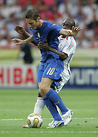 Italian midfielder (10) Francesco Totti collides with French midfielder (6) Claude Makelele.  Italy defeated France on penalty kicks after leaving the score tied, 1-1, in regulation time in the FIFA World Cup final match at Olympic Stadium in Berlin, Germany, July 9, 2006.