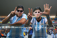 Argentina supporters wearing Lionel Messi masks gesture the result of last night's Germany vs Brazil semi final, 7-1