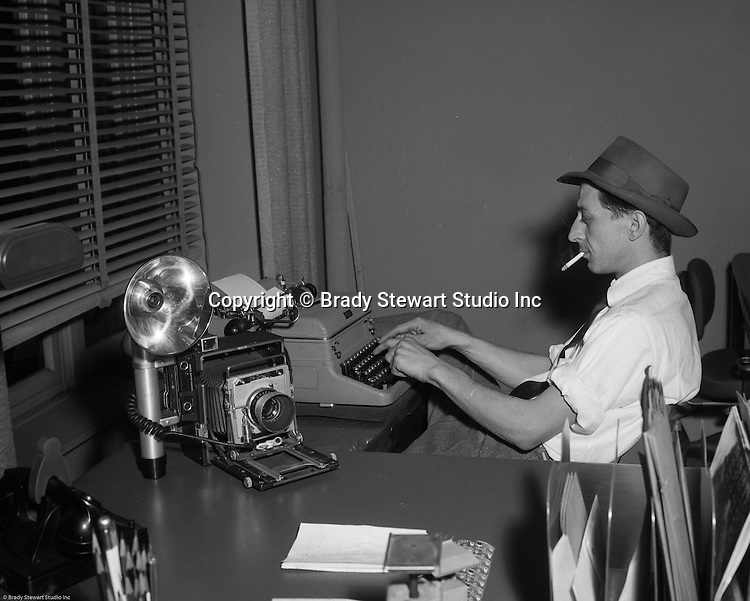 Brady Stewart Studio: The second downtown Pittsburgh studio (1956-1966) was located at 725 Liberty Ave right next to Dimlings Candies and across from Max Azens. <br /> <br /> Ross Catanza filling out paperwork after completing another successful day on location for Brady Stewart Studio.  Ross worked for Brady Stewart Studio from 1950 to 1965 when he left to pursue an award-winning career at the Pittsburgh Post Gazette newspaper.
