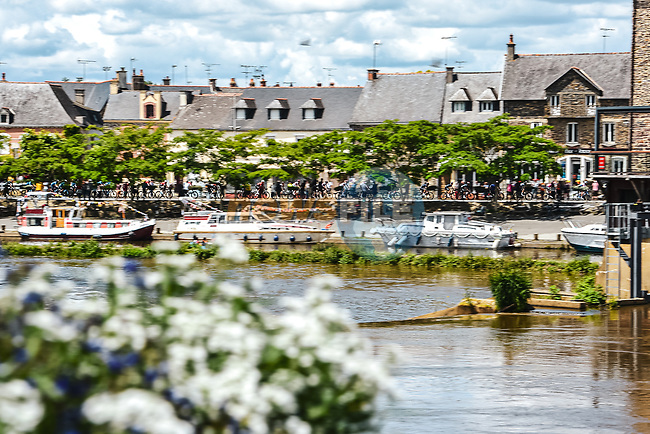 The peloton speed by during Stage 4 of the 2021 Tour de France, running 150.4km from Redon to Fougeres, France. 29th June 2021.  <br /> Picture: A.S.O./Charly Lopez   Cyclefile<br /> <br /> All photos usage must carry mandatory copyright credit (© Cyclefile   A.S.O./Charly Lopez)