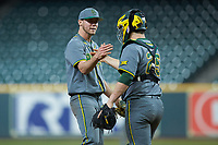 Baylor Bears relief pitcher Luke Boyd (41) shakes hands with catcher Andy Thomas (25) after getting the final out of the game against the Arkansas Razorbacks in game nine of the 2020 Shriners Hospitals for Children College Classic at Minute Maid Park on March 1, 2020 in Houston, Texas. The Bears defeated the Razorbacks 3-2. (Brian Westerholt/Four Seam Images)