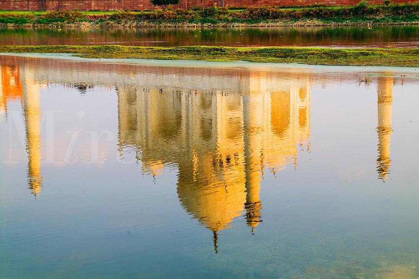 Taj Mahal temple reflection at sunset from Yamuna River, Agra, India