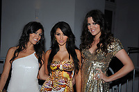 MIAMI BEACH - FL-DECEMBER 31, 2007: (EXCLUSIVE COVERAGE)  Keeping Up With The Kardashians stars Kim Kardashians along with sisters Kourtney and Khloe pose right before midnight on New Year's Eve 2008 in Miami Beach<br /> <br /> People; Kourtney Kardashian; Kim Kardashian: Khloe Kardashian