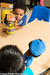 Education Preschool 4-5 year olds two boys playing with puppets and talking