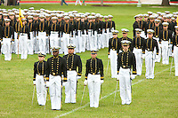 US Naval Academy cadets in formal dress stand at attention in the Color Parade at Worden Field on May 21, 2015 in Annapolis.