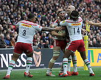 Jack Clifford of Harlequins is congratulated by team mates after scoring an early try