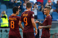 Calcio, Serie A: Roma vs Udinese. Roma, stadio Olimpico, 20 agosto 2016.<br /> Roma's Diego Perotti, left, celebrates with teammates Edin Dzeko, center, and Leandro Paredes, after scoring his second goal on a penalty kick during the Italian Serie A football match between Roma and Udinese at Rome's Olympic Stadium, 20 August 2016. Roma won 4-0.<br /> UPDATE IMAGES PRESS/Riccardo De Luca