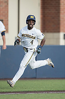 Michigan Wolverines second baseman Ako Thomas (4) sprints to the plate against the Michigan State Spartans during the NCAA baseball game on April 18, 2017 at Ray Fisher Stadium in Ann Arbor, Michigan. Michigan defeated Michigan State 12-4. (Andrew Woolley/Four Seam Images)