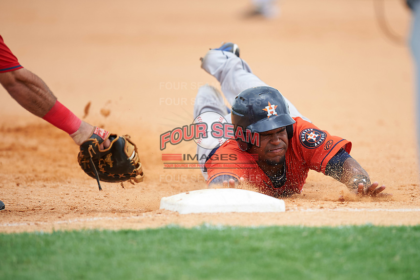 GCL Astros Randy Vasquez (61) dives head first back to first base during a game against the GCL Nationals on August 14, 2016 at the Carl Barger Baseball Complex in Viera, Florida.  GCL Nationals defeated GCL Astros 8-6.  (Mike Janes/Four Seam Images)