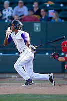 Tim Anderson (7) of the Winston-Salem Dash follows through on his swing against the Salem Red Sox at BB&T Ballpark on April 20, 2014 in Winston-Salem, North Carolina.  The Dash defeated the Red Sox 10-8.  (Brian Westerholt/Four Seam Images)