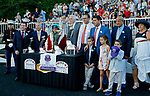 ARLINGTON HEIGHTS, IL - AUGUST 12: The winning connections of Beach Patrol pose for a photograph in the winner's Circle with the trophies on Arlington Million Day at Arlington Park on August 12, 2017 in Arlington Heights, Illinois. (Photo by Jon Durr/Eclipse Sportswire/Getty Images)