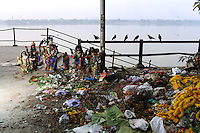 Crows watch over Hindu idols and piles of garbage discarded near the banks of the Ganges River. India. November, 2013
