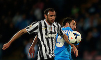 Calcio, Serie A: Napoli vs Juventus. Napoli, stadio San Paolo, 30 marzo 2014. <br /> Juventus defender Giorgio Chiellini, left, and Napoli forward Gonzalo Higuain, of Argentina, fight for the ball during the Italian Serie A football match between Napoli and Juventus at Naples' San Paolo stadium, 30 March 2014.<br /> UPDATE IMAGES PRESS/Isabella Bonotto