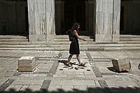 Pictured: A woman walks amongst fallen debris in central Athens, Greece. Friday 19 July 2019<br /> Re:A 5.3-magnitude has struck Greece, 14 miles northwest of Athens shortly after 2pm local time.