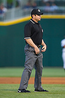 Third base umpire Carlos Torres during the International League game between the Durham Bulls and the Charlotte Knights at BB&T Ballpark on April 24, 2014 in Charlotte, North Carolina.  The Knights defeated the Bulls 4-3.  (Brian Westerholt/Four Seam Images)