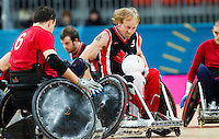 18 APR 2012 - LONDON, GBR - Canadian Garett Hickling (CAN) (Class 3.5) (centre) races for the goal line during the London International Invitational Wheelchair Rugby Tournament match against Great Britain at the Olympic Park Basketball Arena in Stratford, London, Great Britain (PHOTO (C) 2012 NIGEL FARROW)