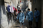 Palestinian volunteers sprays disinfectant a street at al-Shati refugee camp in Gaza City on March 16, 2020, during a campaign by Hamas to stem a novel coronavirus outbreak. Photo by Osama Baba