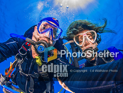 """22 July 2015: SCUBA Divers Sally Herschorn and Ed Wolfstein, pose for an underwater """"selfie"""" image at Ocean Pointe Reef, on the North Shore of Grand Cayman Island. Located in the British West Indies in the Caribbean, the Cayman Islands are renowned for excellent scuba diving, snorkeling, beaches and banking.  Mandatory Credit: Ed Wolfstein Photo *** RAW (NEF) Image File Available ***"""