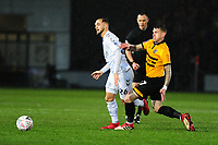 Lewis Wing of Middlesbrough battles with Scot Bennett of Newport County during the FA Cup Fourth Round Replay match between Newport County and Middlesbrough at Rodney Parade in Newport, Wales, UK. Tuesday 05 February 2019