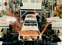 1985 FILE PHOTO - ARCHIVES -<br /> <br /> Making plans: GM chairman Roger Smith; right; says $75 million is being invested in its Oshawa centre; shown above; to produce two new products. Smith denies threatening to close the Quebec plant; but is mum about any future investment there.<br /> <br /> PHOTO :  Keith  BEATY  - Toronto Star Archives - AQP