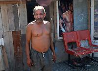 """ROMANIA, Tulcea, Viitorului Street, 2010/08/24.Half of the Roma families living in the district of Tulcea Viitorului, bordering the former industrial conglomerate, lives in France. This area is one of the poorest in the city without running water and sometimes no electricity. The street of """"future"""" is always paved. The families live mainly social benefits and hope all from one day to join Roma in Saint-Denis (France). .© Bruno Cogez / Est&Ost Photography..Roumanie, Tulcea, quartier de Viitorului, 24/08/2010.La moitié des familles roms vivant dans le quartier Viitorului de Tulcea, en bordure de 'lancien combinat industriel, vit en France. Ce quartier est un des plus pauvre de la ville, sans eau courante et parfois sans électricité. Les familles vivent principalement des allocations sociales et espèrent toutes partir un jour rejoindre les Roms de Saint-Denis..© Bruno Cogez / Est&Ost Photography"""