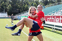 CARY, NC - SEPTEMBER 12: Ryan Williams #13 holds teammate Meredith Speck #25 of the North Carolina Courage before a game between Portland Thorns FC and North Carolina Courage at Sahlen's Stadium at WakeMed Soccer Park on September 12, 2021 in Cary, North Carolina.