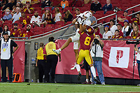 LOS ANGELES, CA - SEPTEMBER 11: Brycen Tremayne #81 of the Stanford Cardinal catches a pass from Tanner McKee #18 defended by Chris Steele #8 of the USC Trojans during a game between University of Southern California and Stanford Football at Los Angeles Memorial Coliseum on September 11, 2021 in Los Angeles, California.