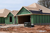Dozens of homes are under construction at Park View subdivision in Lowell, seen March 30 2021, being built by Riverwood Homes.<br />(NWA Democrat-Gazette/Flip Putthoff)