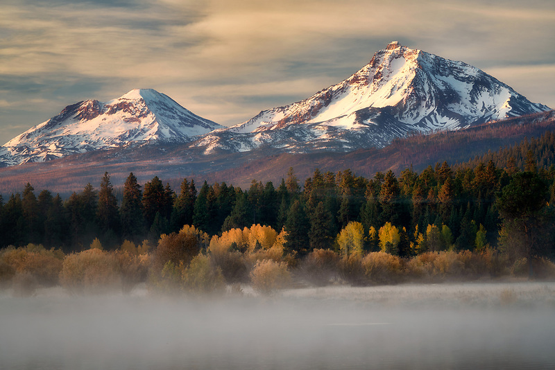 Fog on Black Butte Ranch Ponds with Middle and South Sister Mountains. Oregon