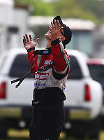 Apr 27, 2014; Baytown, TX, USA; NHRA funny car driver Bob Tasca III reacts after losing in the first round during the Spring Nationals at Royal Purple Raceway. Mandatory Credit: Mark J. Rebilas-