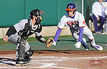 Steve Wilkerson (17) of the Clemson Tigers scores on a Shane Kennedy triple with Wofford Terriers catcher Luke Feisal (2) defending in the third inning of a game on Wednesday, March 6, 2013, at Doug Kingsmore Stadium in Clemson, South Carolina. Clemson won, 9-2.