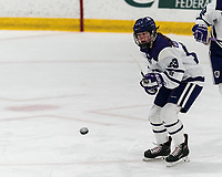 WORCESTER, MA - FEBRUARY 08: Mary Edmonds #13 of Holy Cross flips puck out of the zone during a game between Boston University and College of the Holy Cross at Hart Center Rink on February 08, 2020 in Worcester, Massachusetts.