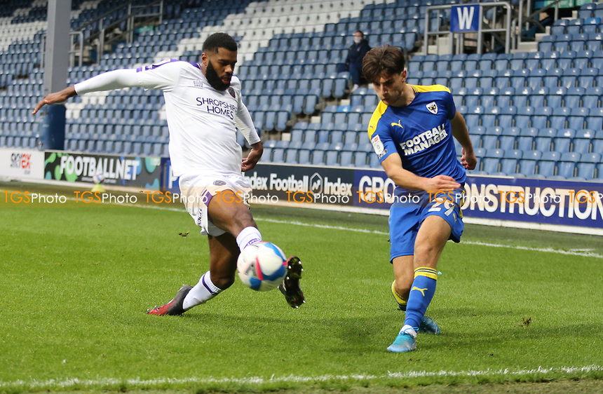 Ryan Longman of AFC Wimbledon cross blocked by Scott Golbourne of Shrewsbury Town during AFC Wimbledon vs Shrewsbury Town, Sky Bet EFL League 1 Football at The Kiyan Prince Foundation Stadium on 17th October 2020
