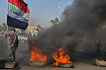 Iraqi protesters take part in an anti-government demonstration and they refused to assign Muhammad Tawfiq Allawi as prime minister and the Representatives parliament failed to hold the emergency session in Iraq's southern city of Nasiriyah in Dhi Qar province, on March 1, 2020. Photo by Wadaa al-Aumry