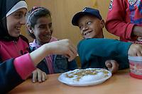 LEBANON Deir el Ahmad, a maronite christian village in Beqaa valley, school for syrian refugee children / LIBANON Deir el Ahmad, ein christlich maronitisches Dorf in der Bekaa Ebene, Schule der Good Shepherds Sisters der maronitischen Kirche fuer syrische Fluechtlingskinder, Junge Ahmad, er ist mit seiner Familie aus Homs geflohen