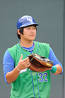 Catcher Jin-Ho Shin (32) of the Lexington Legends before a game against the Greenville Drive on Sunday, August 18, 2013, at Fluor Field at the West End in Greenville, South Carolina. Greenville won Game 2 of a doubleheader, 1-0. (Tom Priddy/Four Seam Images)