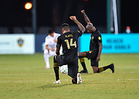 LAKE BUENA VISTA, FL - JULY 18: Mark-Anthony Kaye #14 of LAFC kneels during a game between Los Angeles Galaxy and Los Angeles FC at ESPN Wide World of Sports on July 18, 2020 in Lake Buena Vista, Florida.