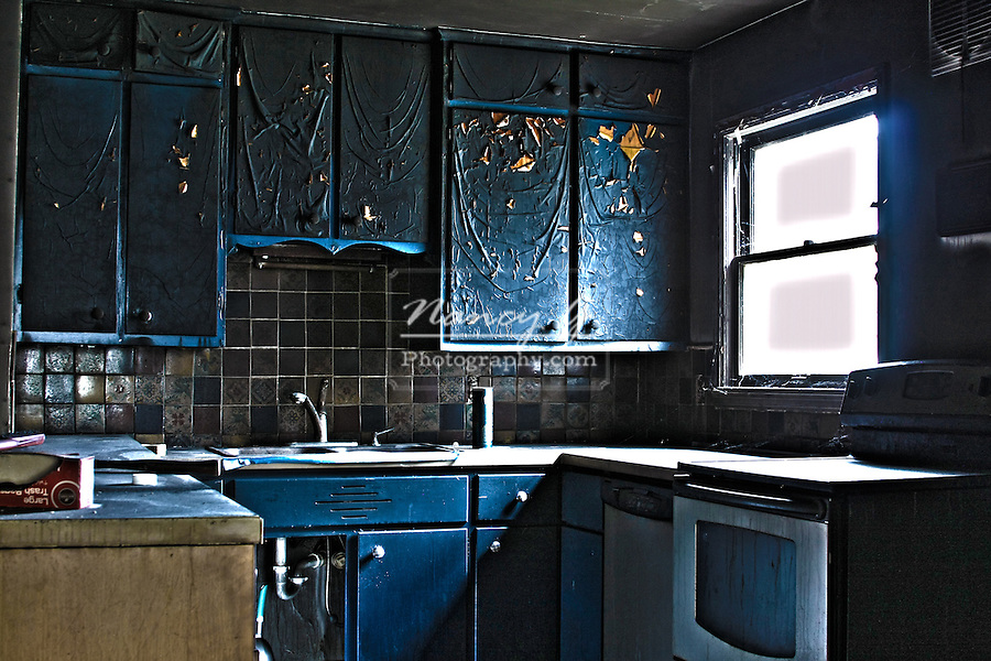 Kitchen fire with burnt cabinets