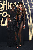LONDON, UK. September 14, 2019: Adut Akech & Naomie Campbell at the Fashion for Relief Show 2019 at the British Museum, London.<br /> Picture: Steve Vas/Featureflash