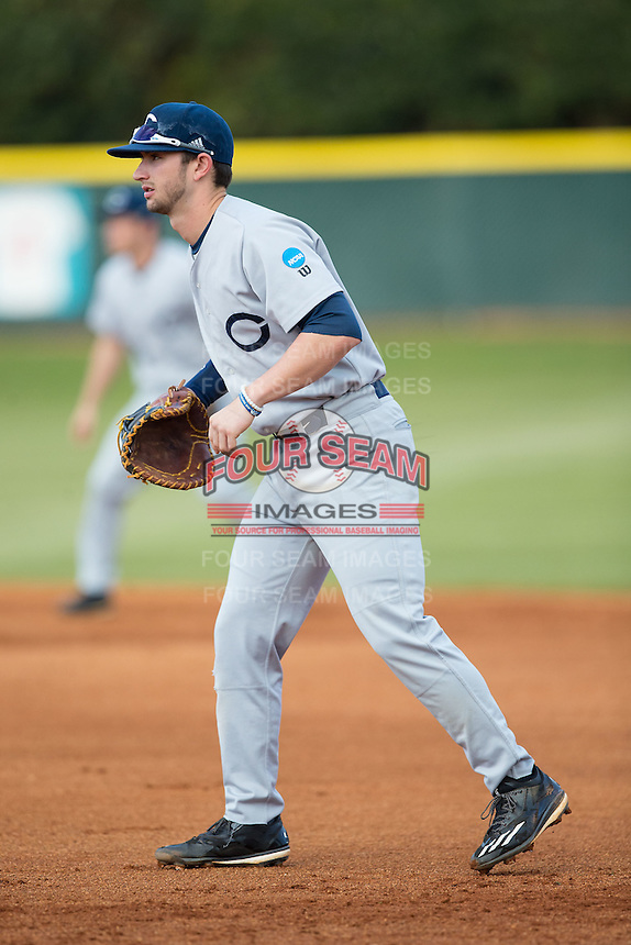 Catawba Indians first baseman Chance Bowden (15) on defense against the Belmont Abbey Crusaders at Abbey Yard on February 7, 2017 in Belmont, North Carolina.  The Crusaders defeated the Indians 12-9.  (Brian Westerholt/Four Seam Images)