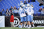 Face-Off Classic: Blue Jays celebrate after scoring during the UMBC v Johns Hopkins mens lacrosse game at M&T Bank Stadium on March 10, 2012 in Baltimore, Maryland. (Ryan Lasek/ Eclipse Sportswire)