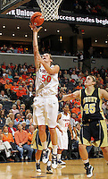 Nov. 14, 2010; Charlottesville, VA, USA;  Virginia forward Chelsea Shine (50) shoots the ball in front of Mount St. Mary's forward Rachel Mathews (45) during the game at the John Paul Jones Arena. Virginia won 81-58. Mandatory Credit: Andrew Shurtleff