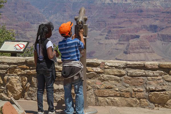 Minority visitors at South Rim of Grand Canyon National Park, Arizona . John offers private photo tours in Grand Canyon National Park and throughout Arizona, Utah and Colorado. Year-round.