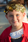 Portrait of a White boy dressed up as a Greek god as part of a mythology pageant at the Los Angeles Greek Festival at St. Sophia's Greek Orthodox Church in Los Angeles, CA, crown of laurels