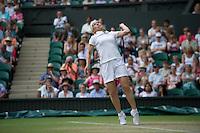 29.06.2010: Wimbledon, SW London, England. Martina Navratilova servers int he ladies singles at the Wimbledon tennis tournament held at the All England Lawn Tennis Club, London, England.